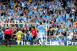 Manchester City's Sergio Aguero scores and celebrates - Photo mandatory by-line: Dougie Allward/JMP - Tel: Mobile: 07966 386802 22/09/2013 - SPORT - FOOTBALL - City of Manchester Stadium - Manchester - Manchester City V Manchester United - Barclays Premier League