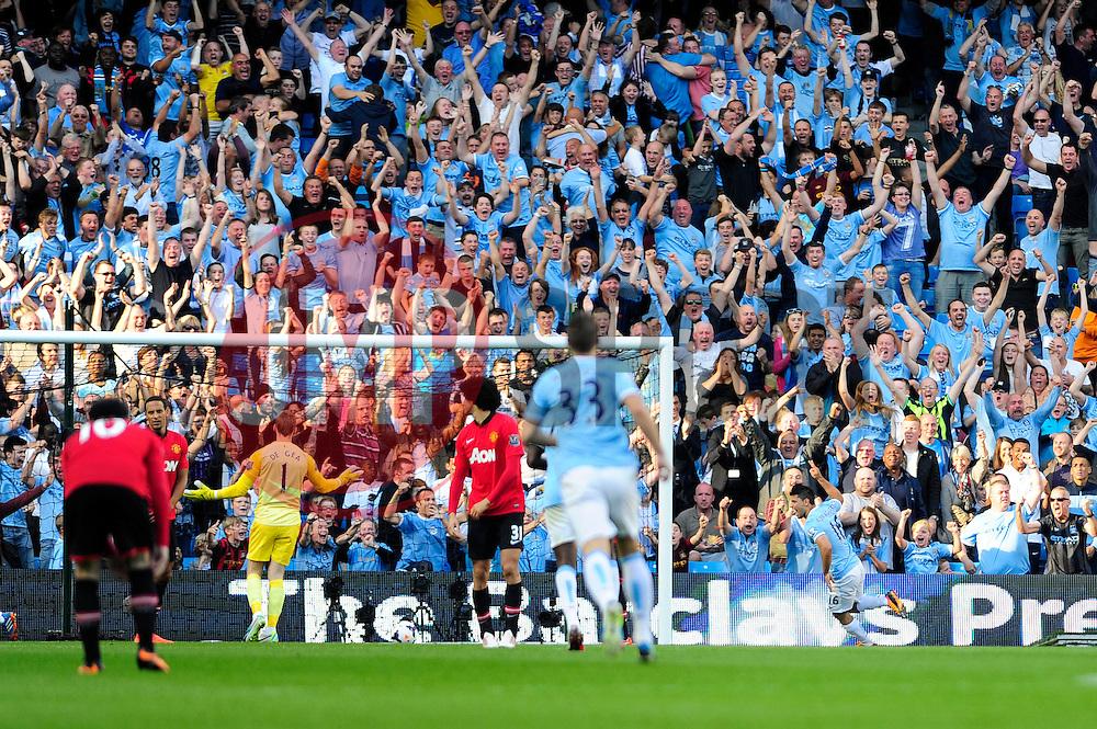Manchester City's Sergio Aguero scores and celebrates - Photo mandatory by-line: Dougie Allward/JMP - Tel: Mobile: 07966 386802 22/09/2013 - SPORT - FOOTBALL - City of Manchester Stadium - Manchester - Manchester City V Manchester United - Barclays Premier League