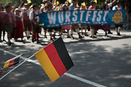 Wurstfest sign and German flags at the German Steuben Parade along Fifth Avenue.