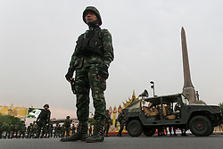 © Licensed to London News Pictures. 26/05/2014. A soldier stands in front of a Humvee army vehicle in front of Victory monument during a Anti-Coup protest in Bangkok Thailand. Today Thailand's King formally approved Thai army chief General Prayut Chan-O-Cha as head of the nation's new military junta.  Photo credit : Asanka Brendon Ratnayake/LNP