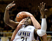 (1/4/10) - (Harrisonburg).James Madison's Denzel Bowles is fouled as he goes for an offensive rebound against Delaware at the JMU Convo on Monday night..(Pete Marovich/Daily News-Record).