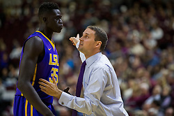 LSU head coach Will Wade points to the shot clock while talking to LSU forward Mayan Kiir (35) during the first half of an NCAA college basketball game Saturday, Jan. 6, 2018, in College Station, Texas. (AP Photo/Sam Craft)