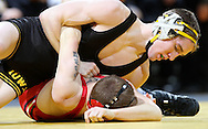 Iowa's Matt McDonough tries to turn Southern Illinois Edwardsville's Paul Myers during the 125-pound bout of their dual at Carver-Hawkeye Arena, 1 Elliot Drive in Iowa City on Friday evening January 7, 2010. McDonough pinned Myers in 1:47 and Iowa defeated Southern Illinois Edwardsville 49-0.