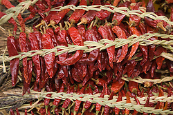 Asia, Japan, Gifu prefecture, Takayama (also known as Hida-Takayama), strands of dried chilis on display at market