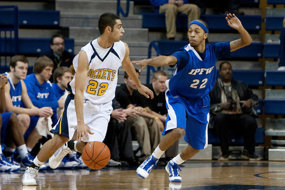 10 December 2009:  Toledo's Jay Shunnar (22) and IPFW's Jeremy Mixon (22) during the NCAA basketball game between IPFW and the Toledo Rockets at Savage Arena in Toledo, OH.