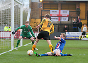 A tackle in the box denies Cambridge No 8 Luke Berry during the Sky Bet League 2 match between Cambridge United and Carlisle United at the R Costings Abbey Stadium, Cambridge, England on 16 April 2016. Photo by Nigel Cole.