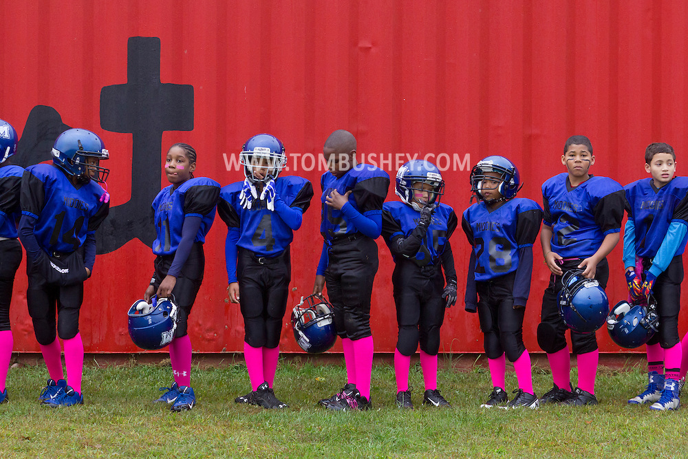 Huguenot, New York - Middletown players line up to be weighed in before an Orange County Youth Football League Division II game on Oct. 4. 2014.