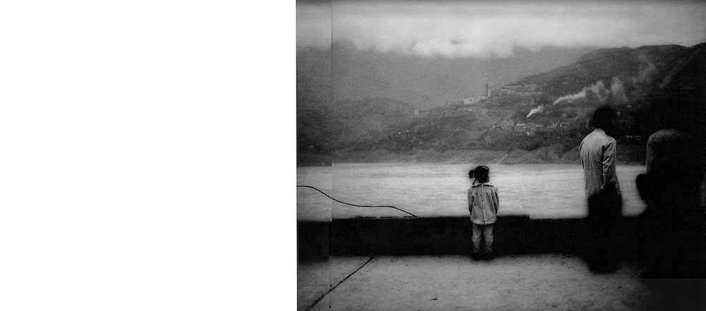Young girl looks out from high above the Yangtze River (but not high enough to escape the inundation that came in June 2003 when the gates of the Three Gorges Dam were closed), Former Sichuan Province (Chongqing Municipality), China.  1997