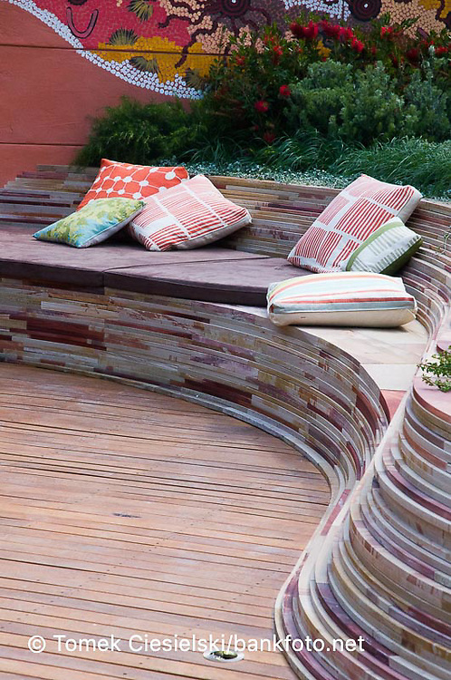 Curved sandstone wall seats and table with hardwood decking