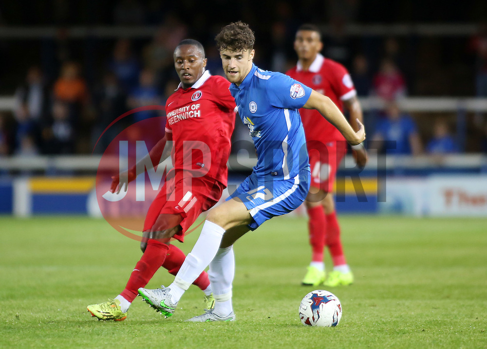 Alex Davey of Peterborough United in action with Callum Harriott of Charlton Athletic - Mandatory byline: Joe Dent/JMP - 07966386802 - 25/08/2015 - FOOTBALL - ABAX Stadium -Peterborough,England - Peterborough United v Charlton Athletic - Capital One Cup - Second Round
