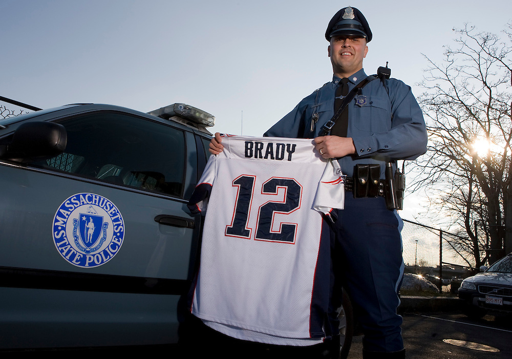 120201, South Boston- State Trooper David Chapman poses at State Police Station in South Boston on Wednesday with his Tom Brady jersey.  Chapman, who has season tickets, will work on Superbowl Sunday, but will wear his MHK pin in support of his team....Herald Photo by Brooks Canaday..EXIF: Canon EOS-1Ds Mark II; 2/1/12 @ 3:04:33 PM; 24mm, 1/200@f8; 100asa; Manual;