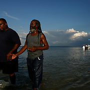 (09/14/08)  After his baptism Charles Baldwin is lead back to the shores of Tampa Bay as members of St. Petersburg celebrate the success of the group Sevex7's efforts to bring peace to the streets of South St. Petersburg.  On Sunday more than 300 attended the mass baptism of more than 50 people at North Shore park.  Sevenx7 is an effort by 49 plus churches to bring peace and stop the violence on the South Side of St. Petersburg. They held seven revivals in seven different places for the last seven days. (Photos WILLIE J. ALLEN JR. | Times).