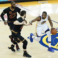 12 June 2017: Cleveland Cavaliers forward Kevin Love (0) and Cleveland Cavaliers forward LeBron James (23) defend on Golden State Warriors forward Kevin Durant (35) during the Golden State Warriors 129-120 victory over the Cleveland Cavaliers, in game 5 of the 2017 NBA Finals, at the Oracle Arena, Oakland, California, USA.
