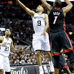 Jun 13, 2013; San Antonio, TX, USA; San Antonio Spurs point guard Tony Parker (9) drives to the basket against Miami Heat center Chris Bosh (1) during the first quarter of game four of the 2013 NBA Finals at the AT&T Center. Mandatory Credit: Derick E. Hingle-USA TODAY Sports