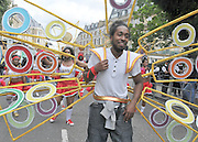 NOTTING HILL, LONDON Crowds enjoy the first day of the Notting Hill Carnival. Sunday's parade is made up of child friendly floats and entertainment.  A police operation costing an estimated £6m has been launched around the carnival site. 29 August 2010. STEPHEN SIMPSON..