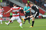 Sam Winnall of Barnsley FC shoots at goal during the Sky Bet League 1 match between Doncaster Rovers and Barnsley at the Keepmoat Stadium, Doncaster, England on 3 October 2015. Photo by Ian Lyall.