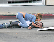 "May 14th 2010. Los Angeles, CA. ***EXCLUSIVE*** Adam Levine with his beautiful Russian Supermodel girlfriend Anne Vyalitsyna filming a Maroon 5 Music Video for their song; ""Misery"". The sexy couple filmed various scenes of loving affection with passionate kissing followed by scenes of humorous violence and destruction. In this action packed Music Video shot on the streets of Downtown Los Angeles, Adam Levine and his band mates are fleeing from Anne Vyalitsyna who is humorously trying to kill them in various ways. Scenes include a missile gun attack and knife throwing from Anne, Adam being hit by a car while running away, Adam being close lined by Anne off a motorcycle that he is fleeing on,  Adam being kicked through a cafe window as well as being ejected from the window of a high rise building. The couple were constantly kissing, hugging and holding hands while on set. They both shared a big luxury trailer while not filming. Photo by Eric Ford/ On Location News. 818-613-3955. info@onlocationnews.com"