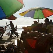 Vendors and parasol umbrellas in Montañita, Ecuador.