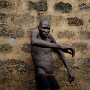 An inmate with a mental condition, in the patio area of Juba Central Prison.