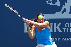 July 31, 2011; Stanford, CA, USA;  Marion Bartoli (FRA) returns the ball against Serena Williams (USA), not pictured, during the finals of the Bank of the West Classic women's tennis tournament at the Taube Family Tennis Stadium. Williams defeated Bartoli 7-5, 6-1.