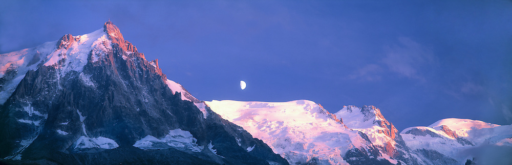 Aiguille du Midi and Mont Blanc on far right, moon rise, Alps, Haute Savoie, France