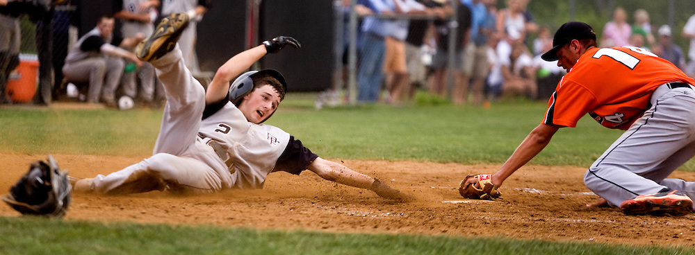 Jackson Rogers of Potomac Falls is safe scorining in the fourth inning during the Panthers' 13-10 win over the Brentsville Tigers on June 4 in Sterling taking the AA Region II championship for the second year in a row.--Times-Mirror Photo/Greg Nash