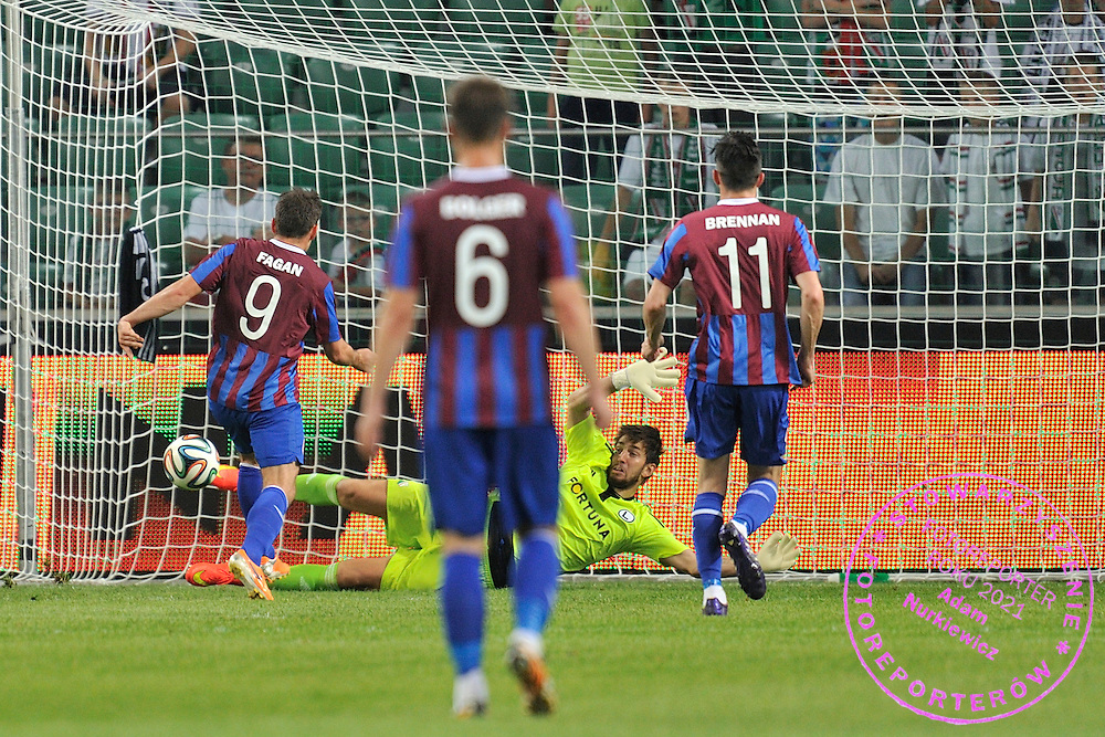 Christy Fagan of St Patrick's (L) shoots goal for his team next to Legia's goalkeeper Dusan Kuciak (C) during Second qualifying round UEFA Champions League soccer match between Legia Warsaw and St. Patrick's Athletic at Pepsi Arena in Warsaw, Poland.<br /> <br /> Poland, Warsaw, July 16, 2014<br /> <br /> Picture also available in RAW (NEF) or TIFF format on special request.<br /> <br /> For editorial use only. Any commercial or promotional use requires permission.<br /> <br /> Mandatory credit:<br /> Photo by &copy; Adam Nurkiewicz / Mediasport