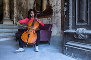 "Grether Ballaga Perez, 25,  plays the cello for the orchestra of the Grand Havana Theater of Cuba. She studied music at the prestigious ""Instituto Superior de Arte"" and dreams of playing for an orchestra outside of Cuba. ""The hardest thing in my life was when my father disappeared when I was 15 year old. Everything in my life changed after that and we still don't know where he is. He worked on a cargo ship so we think maybe he's in Europe with another family."" Of Cuban women, she says ""a Cuban woman can become what she wants to be in this culture. I believe we have the same rights as men and are prepared to face any system, any society."""