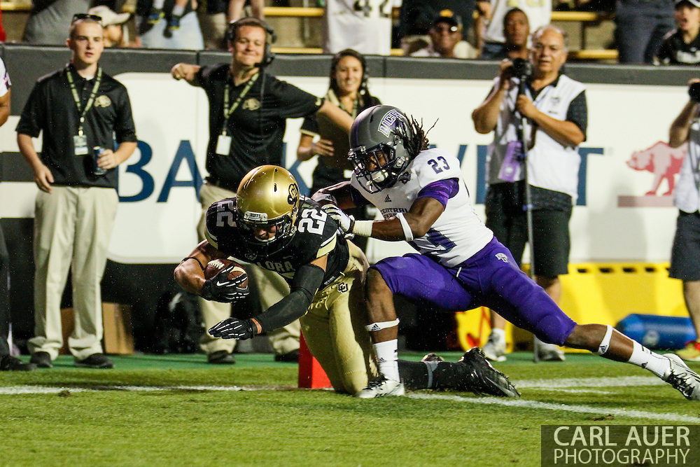 September 7th, 2013 - Colorado Buffaloes sophomore wide receiver Nelson Spruce (22) dives into the end zone for a touchdown in the fourth quarter of the NCAA football game between the University of Central Arkansas Bears and the University of Colorado Buffaloes at Folsom Field in Boulder, CO