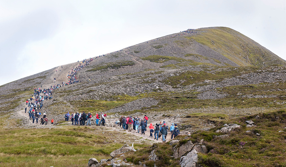 Pilgrims make their way up the mountain for the annual pilgrimage to  Croagh Patrick, Co. Mayo. Pic: Michael Mc Laughlin Thousands of pilgrims navigate up and down the rugged slopes of croagh Patrick in honour of our Patron Saint, Saint Patrick, Ireland's Holy Mountain, Co. Mayo. Pic: Michael Mc Laughlin