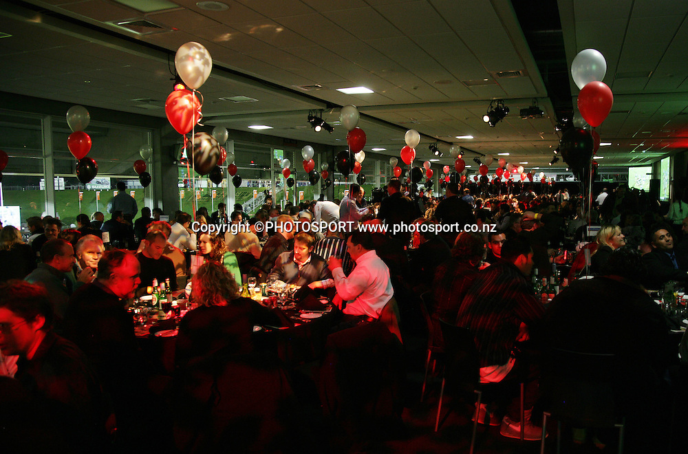 Fans enjoy dinner at the pre match dinner function prior to the start of the match between the Vodafone Warriors and the Penrith Panthers at Mt Smart Stadium, Auckland on Friday 22 June 2007. Photo: Andrew Cornaga/PHOTOSPORT<br />