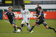 San Jose Earthquakes Brad Ring (Black - 5) and Hunter Gorski (Black-35) put the squeeze on AIK Sweden's Nana Attakora (White - 23) in MLS preseason tournament action at Portland, Oregon's Jeld Wen Field. The game ended in a 0-0 draw.
