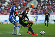 Brighton & Hove Albion centre forward Glenn Murray (17) fends off Wigan Athletic defender Jake Buxton (3) during the EFL Sky Bet Championship match between Wigan Athletic and Brighton and Hove Albion at the DW Stadium, Wigan, England on 22 October 2016.