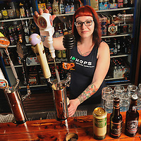 Maaike Brandis pours a cask ale at Cape Fear Wine & Beer in Wilmington, N.C. Photo by Michael Cline Photography