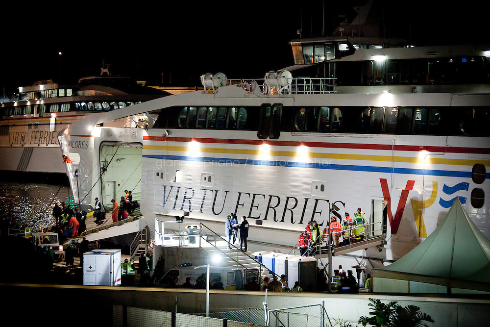 25 February 2011. Valletta, Malta. The first evacuated people get assistance upon their arrival in the harbor of Valletta, Malta. A U.S.-chartered ferry evacuated Americans and other foreigners out of Libya on Friday and brought them to the Mediterranean island of Malta. The Maria Dolores ferry, after three days of delays, brought over 300 passengers, including at 167 U.S. citizens, away from Libya where Colonel Gaddafi's forces continue to clash with anti-government demonstrators.<br /> <br /> <br /> &copy;2011 Gianni Cipriano<br /> cell. +1 646 465 2168 (USA)<br /> cell. +39 328 567 7923<br /> gianni@giannicipriano.com<br /> www.giannicipriano.com
