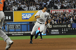 October 18, 2017 - Bronx, NY, USA - The New York Yankees' Brett Gardner heads for home, scoring on a Aaron Judge double in the third inning against the Houston Astros in Game 5 of the American League Championship Series at Yankee Stadium in New York on Wednesday, Oct. 18, 2017. (Credit Image: © Andrew Savulich/TNS via ZUMA Wire)
