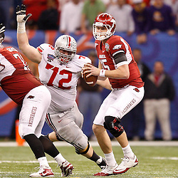 January 4, 2011; New Orleans, LA, USA;  Arkansas Razorbacks quarterback Ryan Mallett (15) is pressured by Ohio State Buckeyes defensive lineman Dexter Larimore (72) during the third quarter of the 2011 Sugar Bowl at the Louisiana Superdome.  Mandatory Credit: Derick E. Hingle