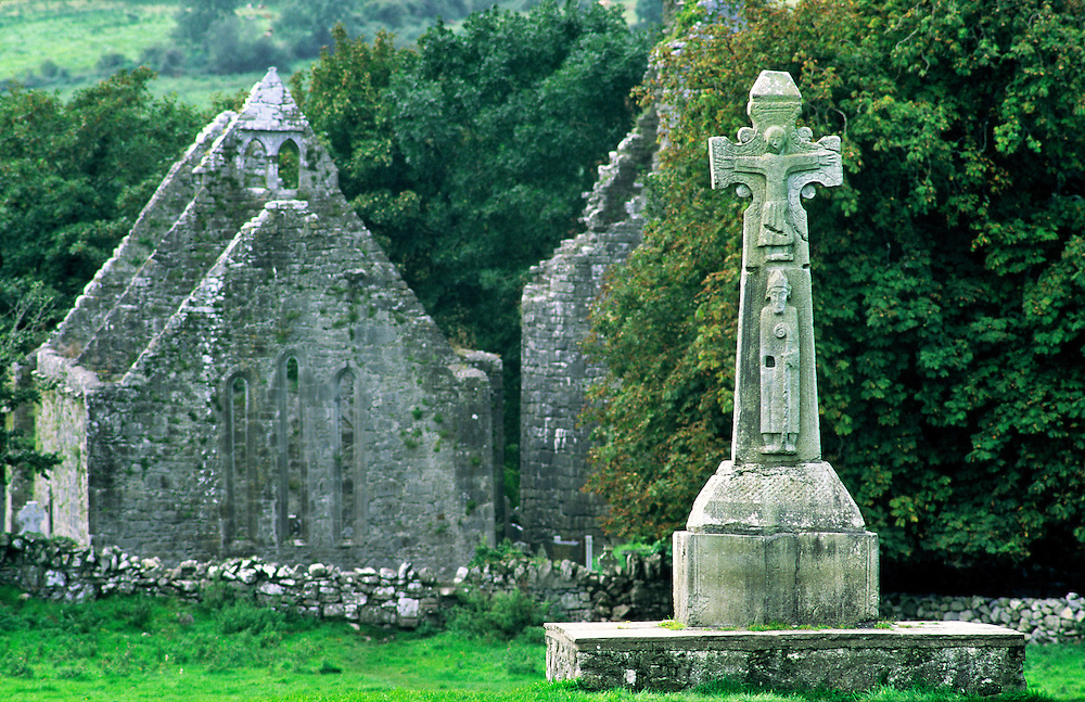 12th C. Saint Tola's Celtic Christian High Cross stands before mediaeval monastic church at Dysert O'Dea, County Clare, Ireland.