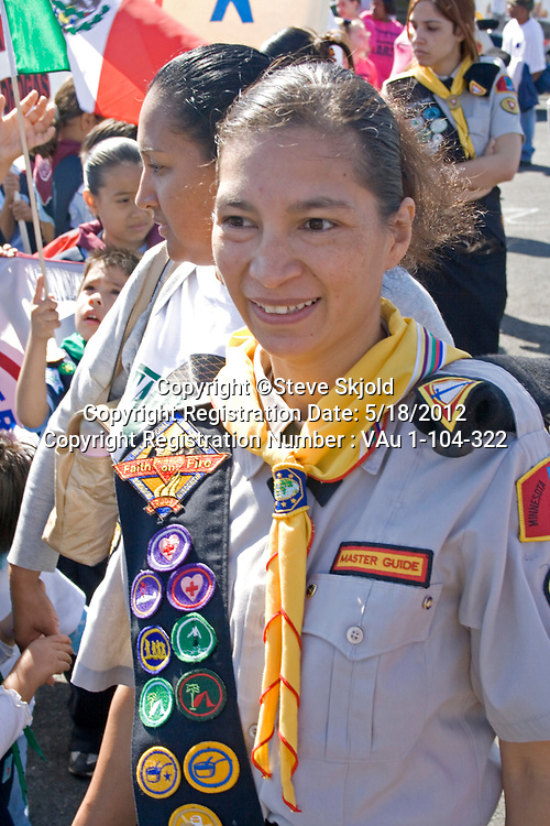 Mexican American Girl Scout Leader wearing sash of merit badges in parade. Mexican Independence Day Minneapolis Minnesota MN USA