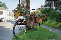 Old bike decoration and sign, Castine, Maine, USA