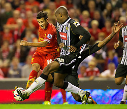 27.08.2013, Anfield, Liverpool, ENG, League Cup, FC Liverpool vs Notts County FC, 2. Runde, im Bild Liverpool's Philippe Coutinho Correia and Notts County's Manny Smith during the English League Cup 2nd round match between Liverpool FC and Notts County FC, at Anfield, Liverpool, Great Britain on 2013/08/27. EXPA Pictures © 2013, PhotoCredit: EXPA/ Propagandaphoto/ David Rawcliffe<br /> <br /> ***** ATTENTION - OUT OF ENG, GBR, UK *****