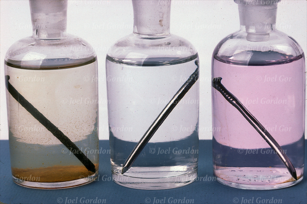Iron nail rust rapidly in tap water (left) contains disolved oxygen and pH between 5 and 6.  Nail does not rust in oxygen-free water (center). Nail rusts slowly in basic solution (right) pink, phenolphthalein indicator added - f20.16a - (1)