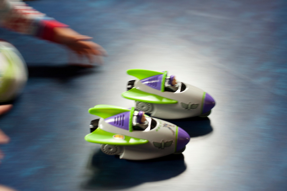 Holden Miller, 4, holds sprint-races with his Buzz Lightyear toy spaceships at the Miller/Stute home in Madison, Wis., on April 15, 2012.