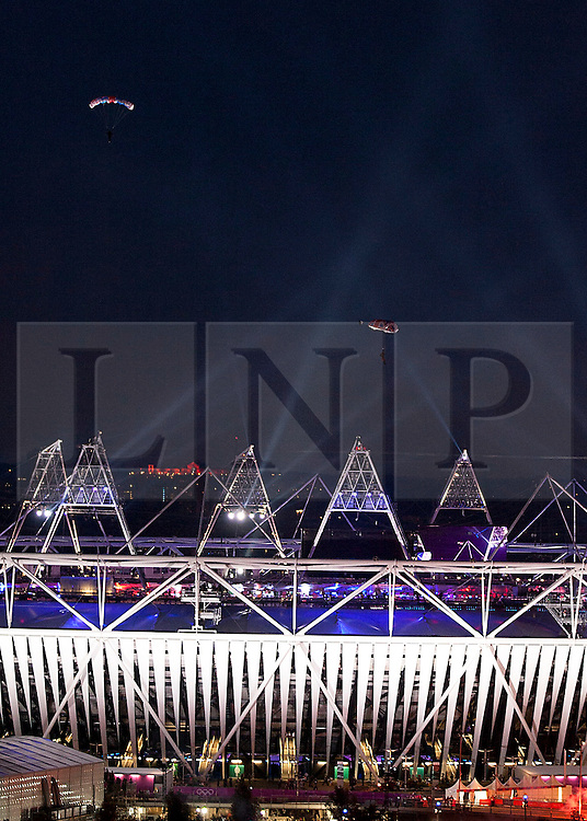© Licensed to London News Pictures. 27/07/2012. LONDON, UK. Parachutists are seen over the Olympic Stadium during the opening ceremony of the 2012 Summer Olympics in London today (27/07/12). Constituting the third time the Olympic Games have been held in Great Britain, the 2012 Olympic Games, also known as the Games of the XXX Olympiad opened this evening with a show, put together by 'Slum Dog Millionaire' director Danny Boyle, entitled 'The Isles of Wonder. Photo credit: Matt Cetti-Roberts/LNP