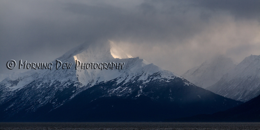 An evening snow storm dusts the mountains along Turnagain Arm.