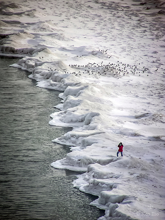 The photographer in red jacket, Lake Michigan in Edgewater, Chicago