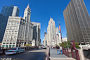 View along N Michigan Ave Bridge showing the Tribune Tower and Wrigley Building in Chicago, IL, USA.