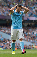 Sergio Aguero of Manchester City has a look of disappointment after missing an opportunity during the Barclays Premier League match at the Etihad Stadium, Manchester<br /> Picture by Russell Hart/Focus Images Ltd 07791 688 420<br /> 08/05/2016