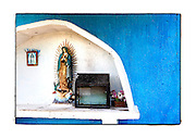 SHOT 11/16/11 11:50:14 AM - A roadside capilla featuring Our Lady of Guadalupe along Carretera Federal 180D near Yaxché, Mexico. Roadside capillas, or tiny chapels, in the Mexican state of Quintana Roo. The capillas are common along the roads and highways of Mexico which is heavily Catholic and are often dedicated to certain patron saints or to the memory of a loved one that has passed away. Often times they contain prayer candles, pictures, personal artifacts or notes. (Photo by Marc Piscotty / © 2011)