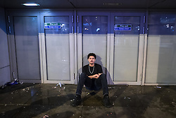 """© Licensed to London News Pictures . 17/12/2016 . Manchester , UK . A man sits on the pavement and closes his eyes , on Withy Grove . Revellers out in Manchester City Centre overnight during """" Mad Friday """" , named for being one of the busiest nights of the year for the emergency services in the UK . Photo credit : Joel Goodman/LNP"""